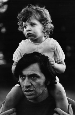 Graham gives young son David a piggyback ride, 1969. Photo: Bonnie MacLean; Collection of David and Alex Graham.