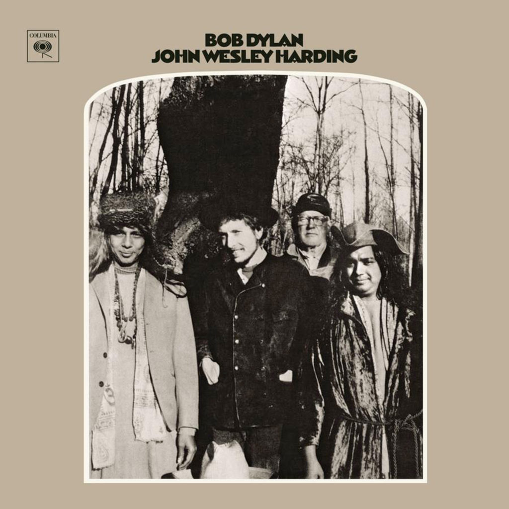 Who are those three other guys with Bob on the John Wesley Harding cover ? and are those really several Beatles hidden in the tree bark ?