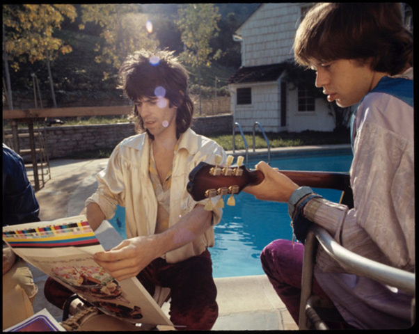 Keith Richard and Mick Jagger review  print proofs of the Let It Bleed album cover art. PHOTO BY ETHAN RUSSELL