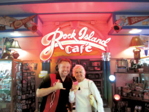 Kathleen King with Mike Gelfo, owner of The Rock Island Cafe, stocks an array of Elvis memorabilia at his '50s-style diner.